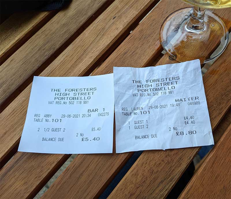 Receipt for beer order - two halves more expensive than a pint.