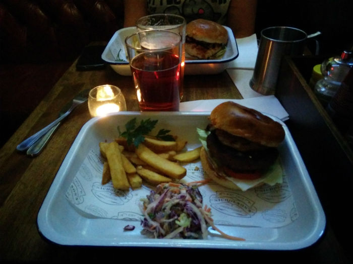 A burger and chips in a roasting tin, weird things food gets served in