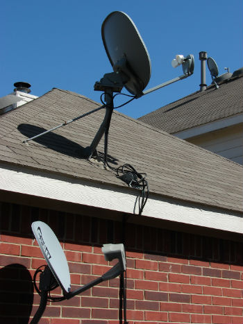 Sky dish on a roof