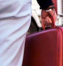 Leaving home, carrying a suitcase