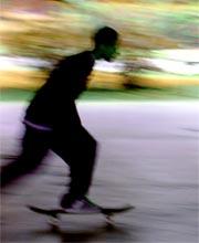 A teenager on a skateboard