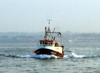 A trawler coming home after a day of fishing