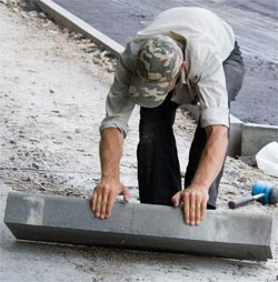 Immigration policies in the UK - A worker building a road