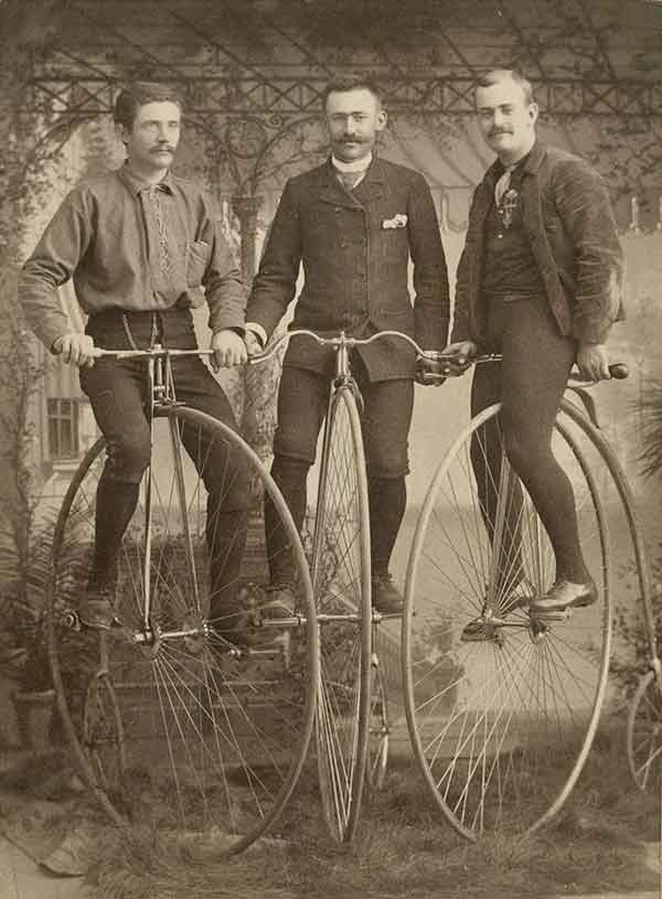 Three men on penny farthings