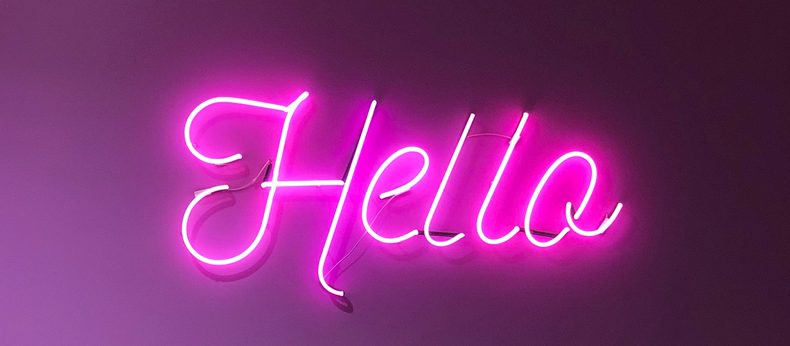 The Animals say hello in bright pink neon