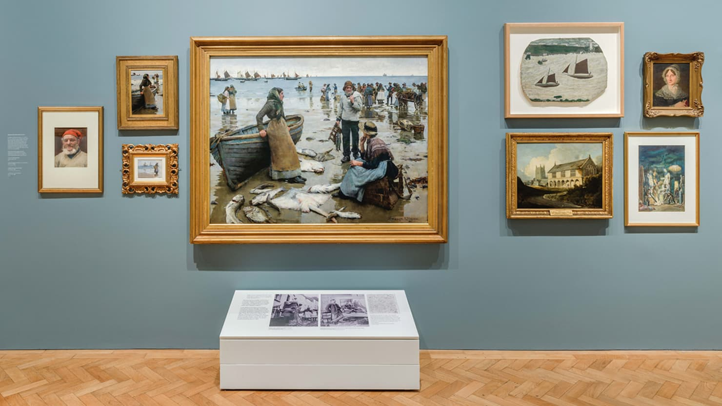 'A Fish Sale on a Cornish Beach' by Stanhope Forbes plus other works in the 'Our Art' gallery at The Box, Plymouth