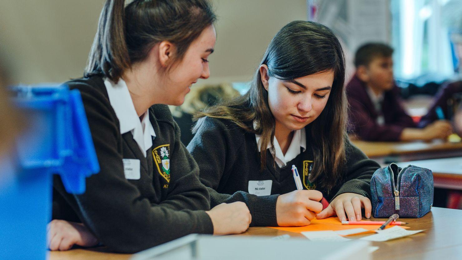School girls taking part in a workshop in their classroom