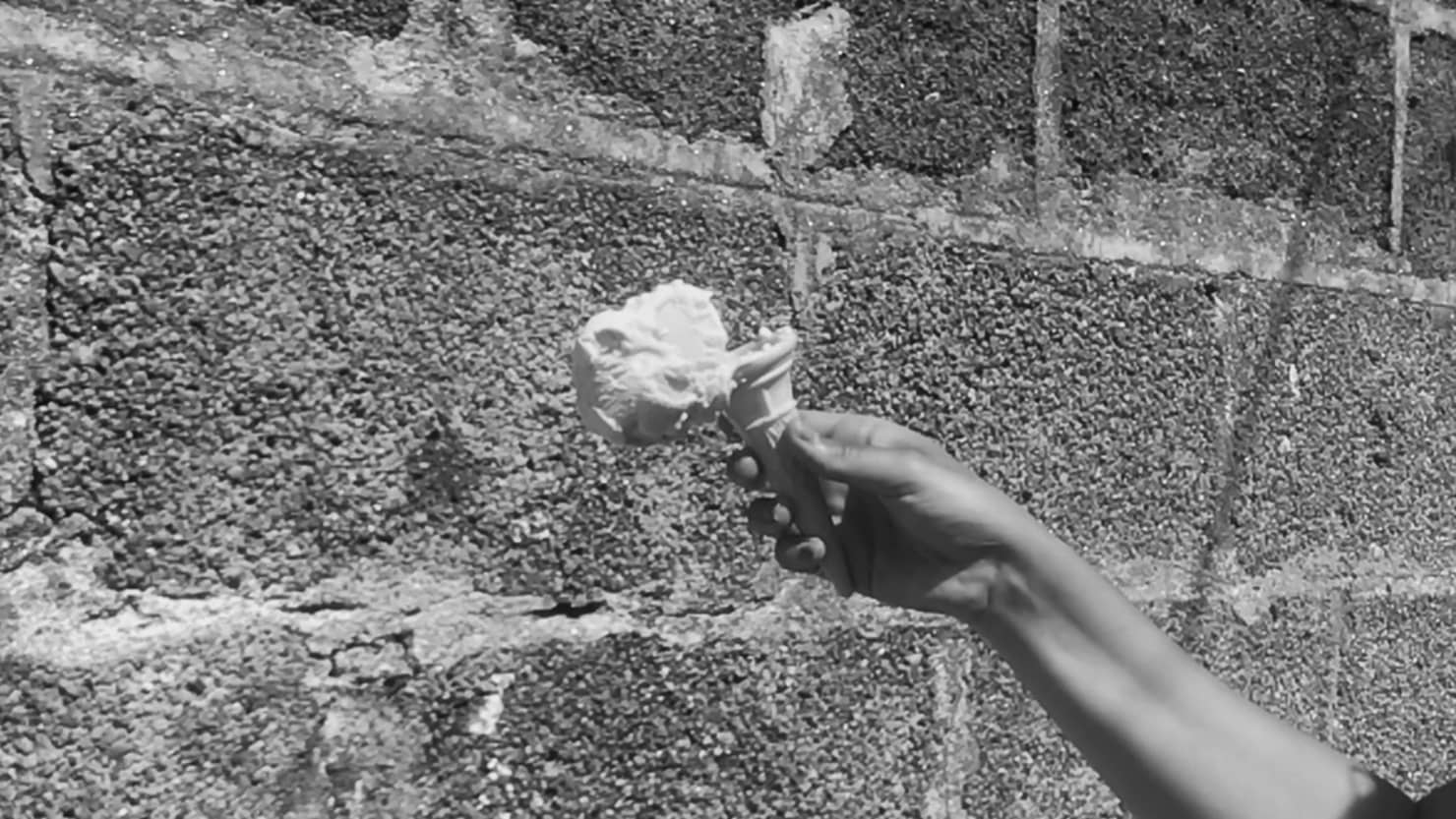 A still from Grace Lightman's music commission featuring an ice cream just about to hit a wall