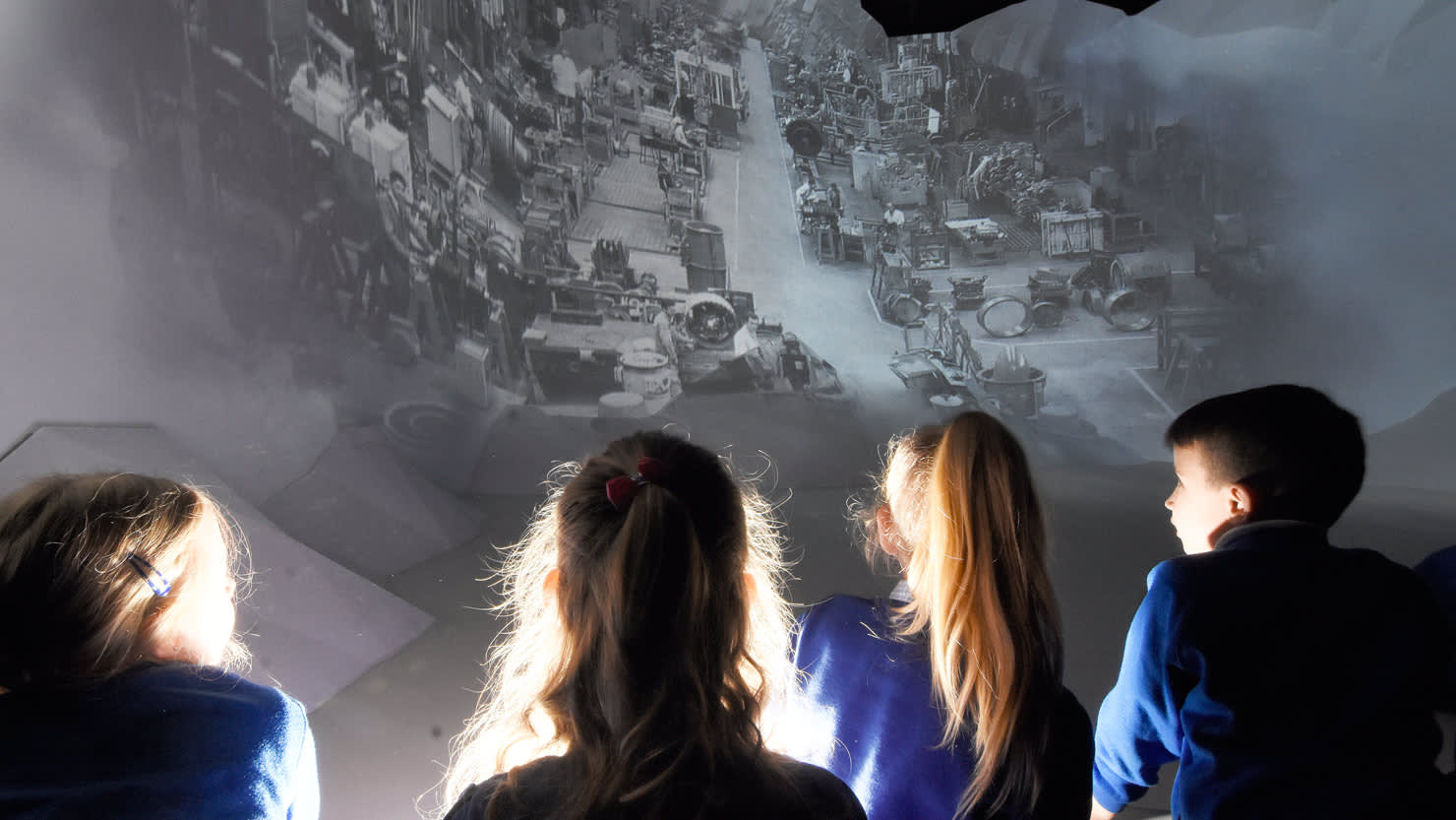 Children watching a projection at The Box, Plymouth