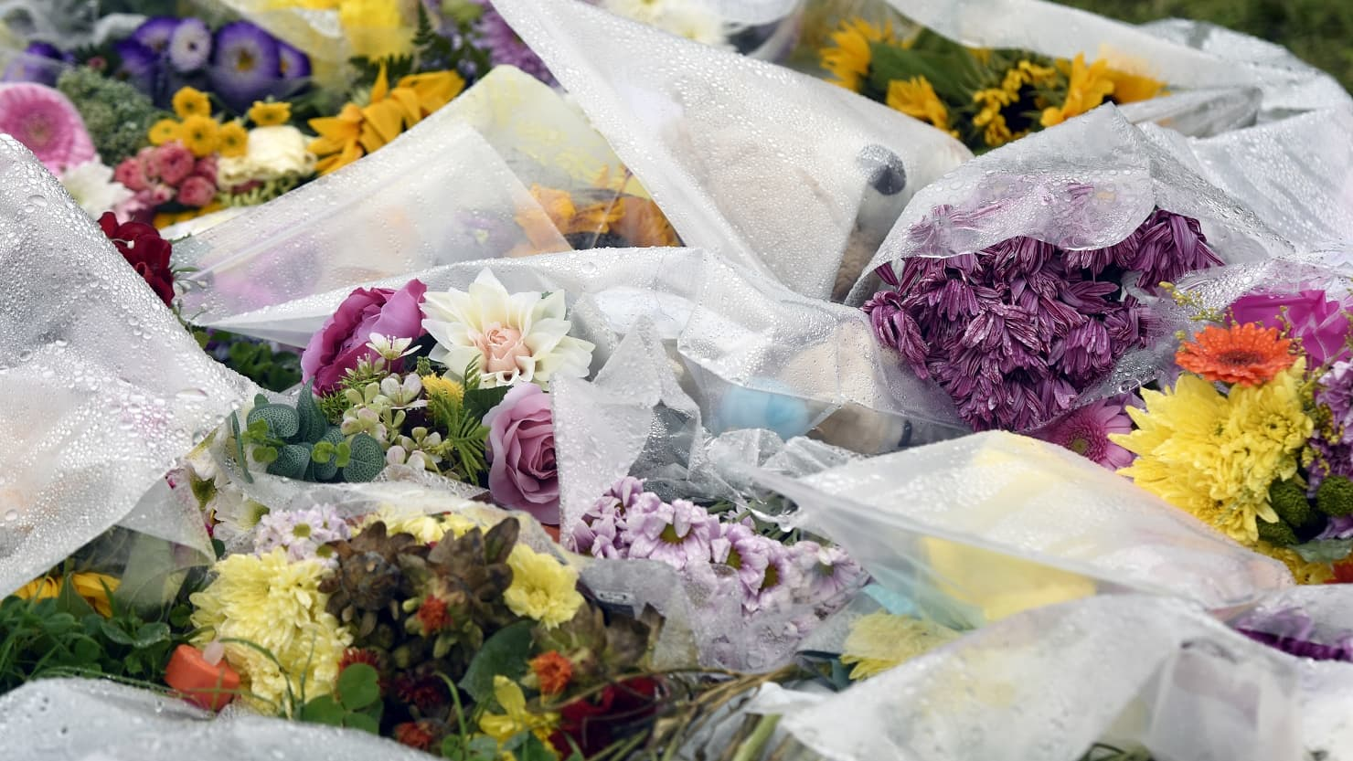 A pile of flowers left in tribute to the victims of the Keyham shootings