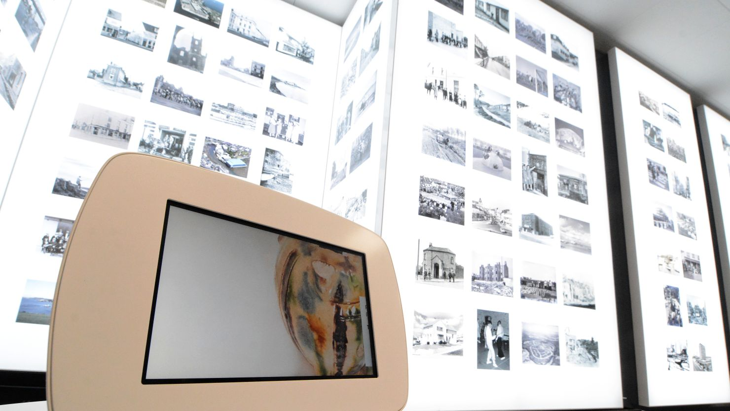 An image of the 'Photo Album' gallery at The Box, Plymouth with images on giant lightboards
