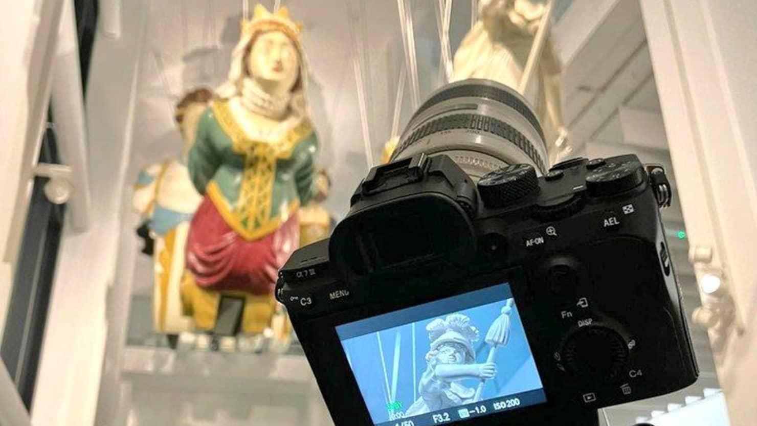 Camera capturing image of figureheads