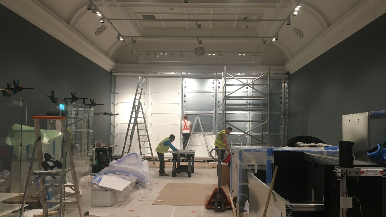 Workmen prepping a gallery for building work