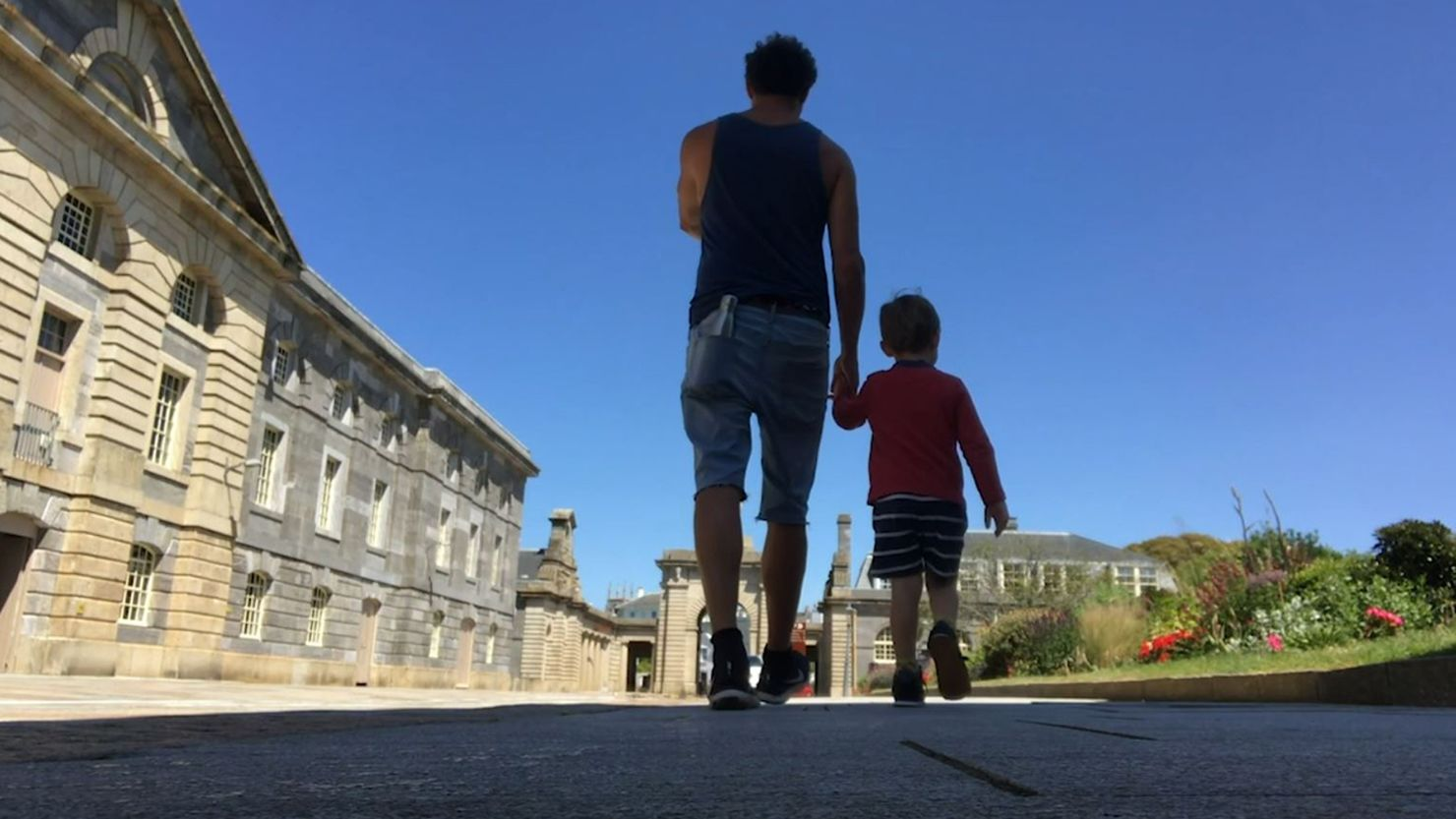 Andy Quick and his son walking through the Royal William Yard in Plymouth - June 2020