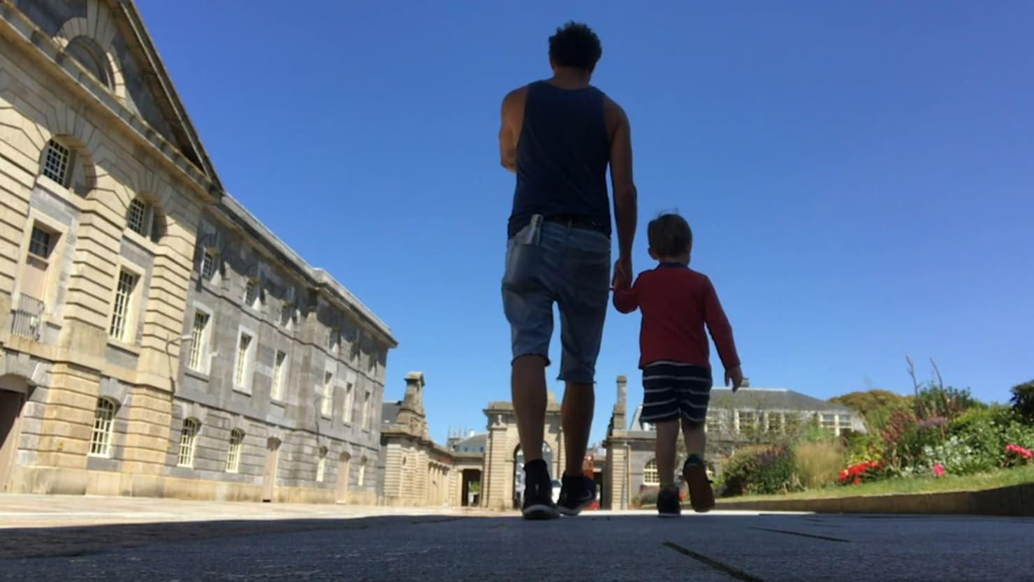 Andy Quick walking through the Royal William Yard with his young son