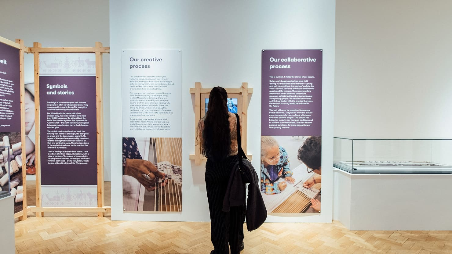 A visitor looking at the Wampum exhibition at The Box, Plymouth