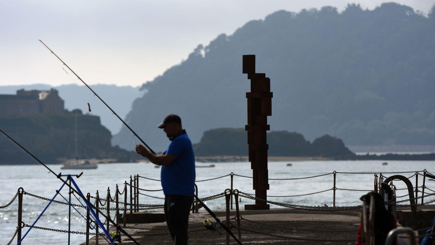 Look II - West Hoe Pier sculpture + fisherman, September 2020