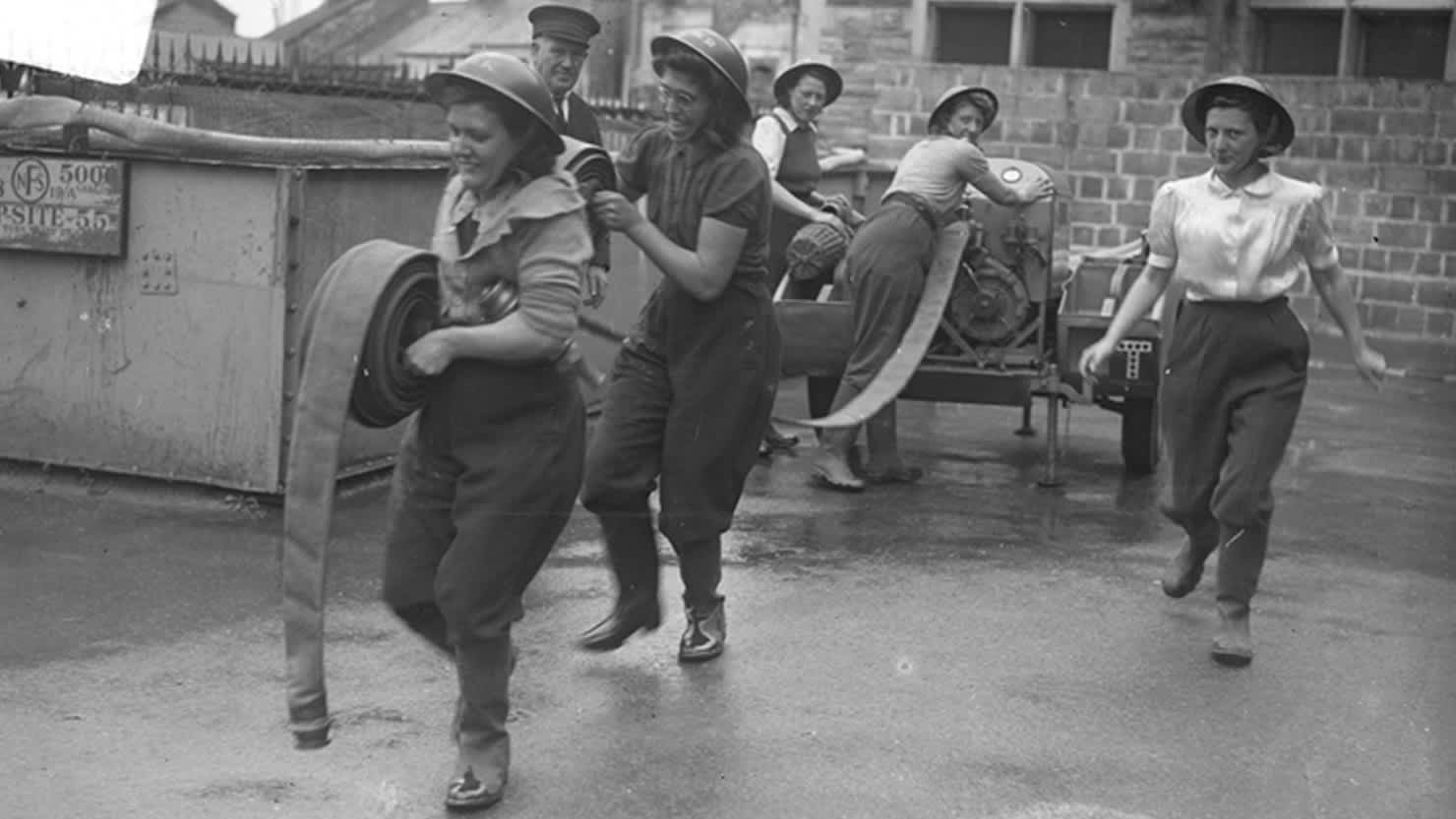 Members of the Women's Auxiliary Fire Service in action during WWII. Courtesy of The Box, Plymouth