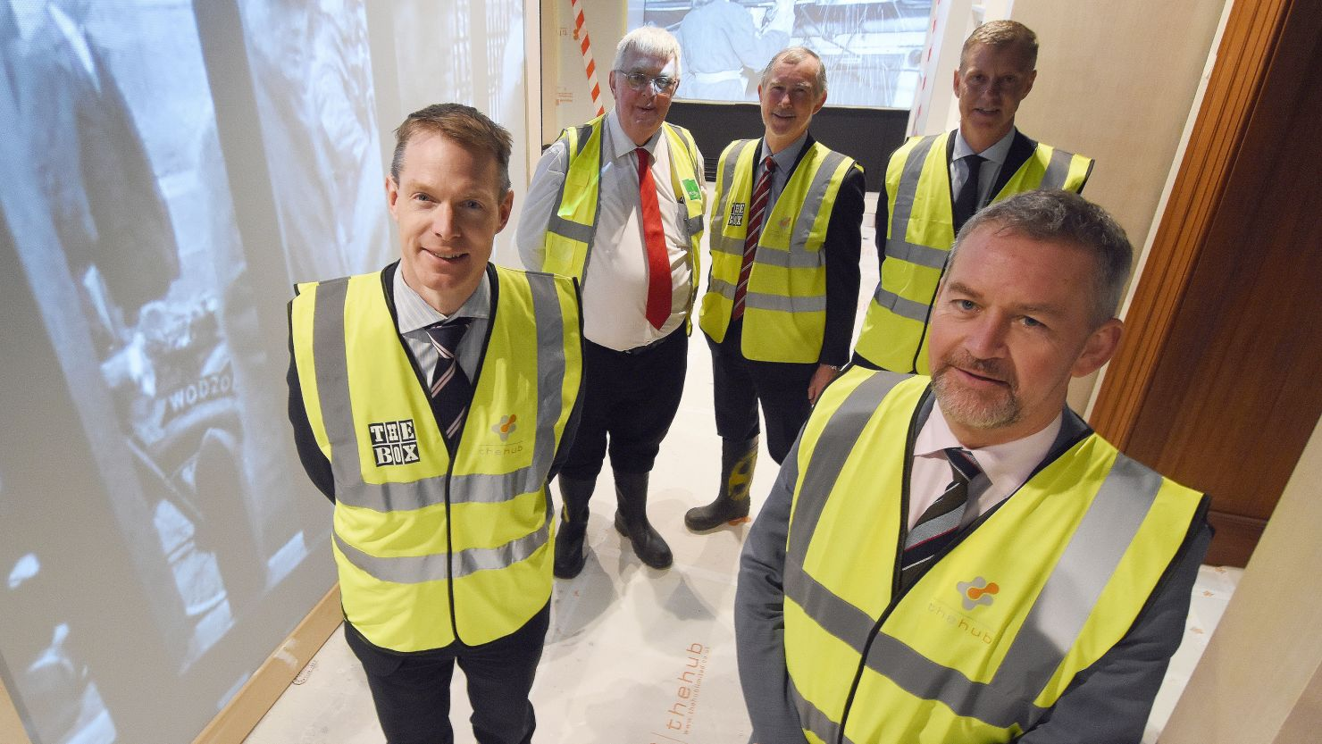 Image of five men in high vis vests in The Box's 'Port of Plymouth' gallery