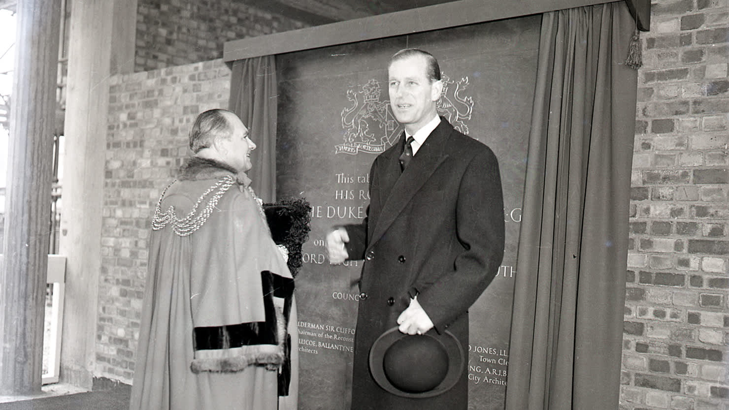 Prince Philip unveils a large tablet inside the incomplete Civic Centre in March 1960 © Mirrorpix