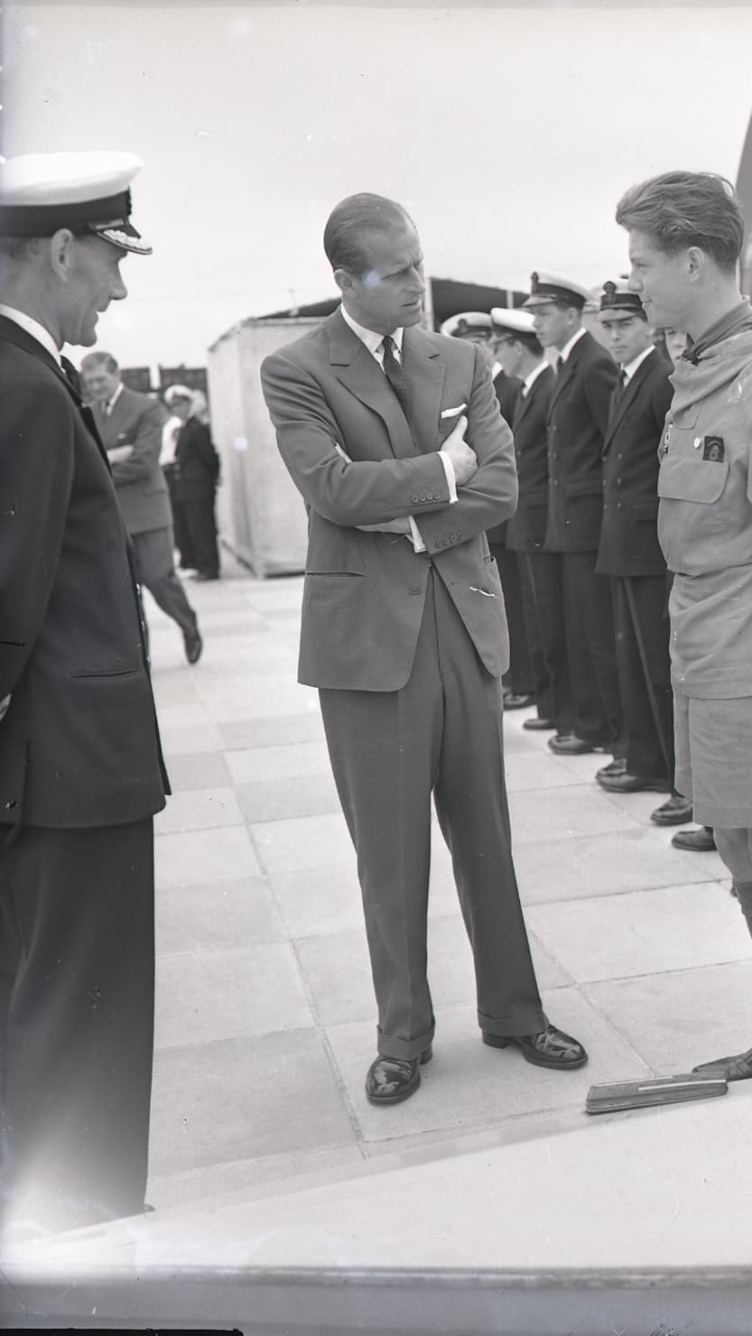 Prince Philip talks to an apprentice at HMS Fisgard, Torpoint on 7 June 1961 © Mirrorpix