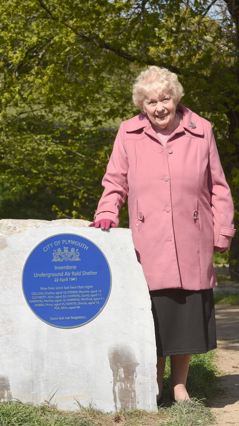 Shirley Stapley with the Inverdene air raid shelter plaque.