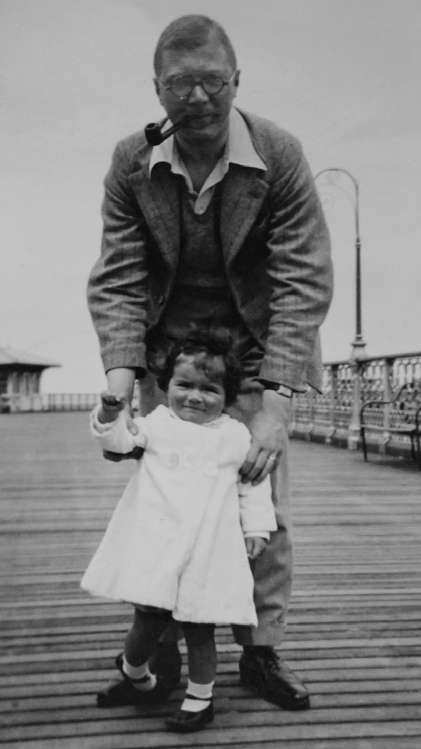 Image of a man standing with a small child