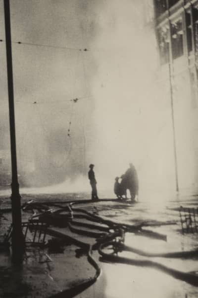 Men hosing down a fire to a building during the Blitz of 1941 in Plymouth