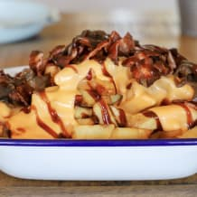 Photo of menu item: American-cheese, Bacon, BBQ sauce, loaded-fries