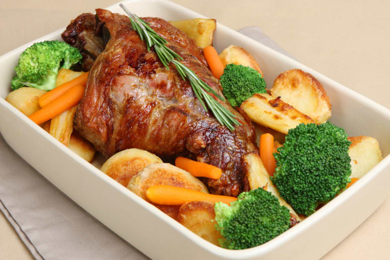 Slow-Roasted Garlic and Thyme Leg of Lamb with Parsnips
