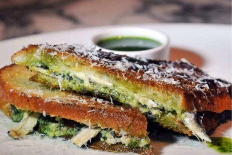 Crusty Italian Bread with Pecorino Toscano Cheese, Fresh Anchovies, & Basil-Parsley Pesto