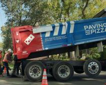 Domino's paving potholes