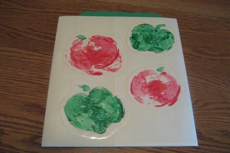 Apples stamped on paper