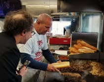 Composer Tod Machover samples the sound of cheesesteak at Pat's King of Steaks.