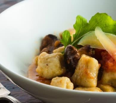 Potato Gnocchi with Chanterelles, Arugula and Tomato