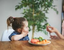 family eating broccoli
