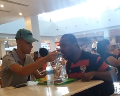 man feeding customer brazil