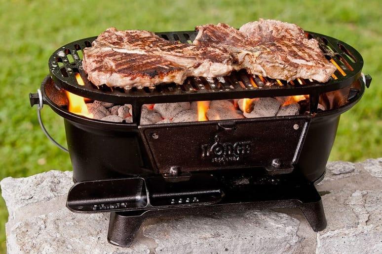 Lodge L410 Pre-Seasoned Sportsman's Charcoal Grill, Black, $86.00