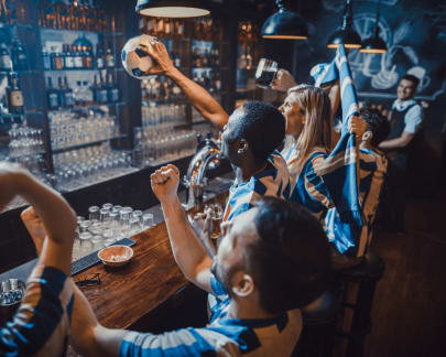 Sports fans drink and cheer the World Cup