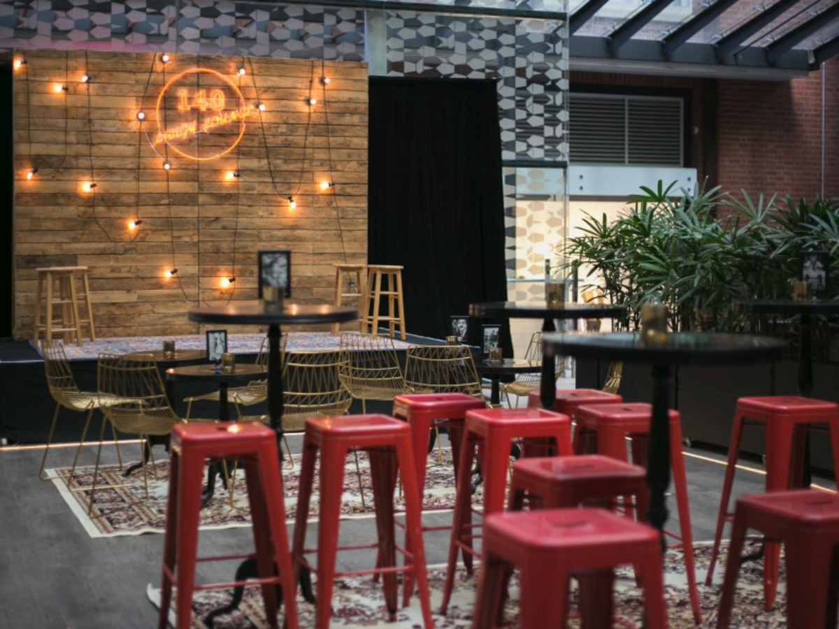 Red Tolix Stools, Gold Arrow Chairs and Pallet Wall Backdrop