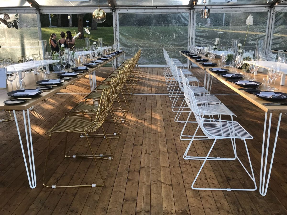 A mix of White & Gold Arrow Chairs with Hairpin Dining Tables
