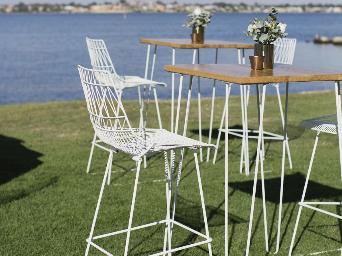 White Arrow Stools and Hairpin Tables