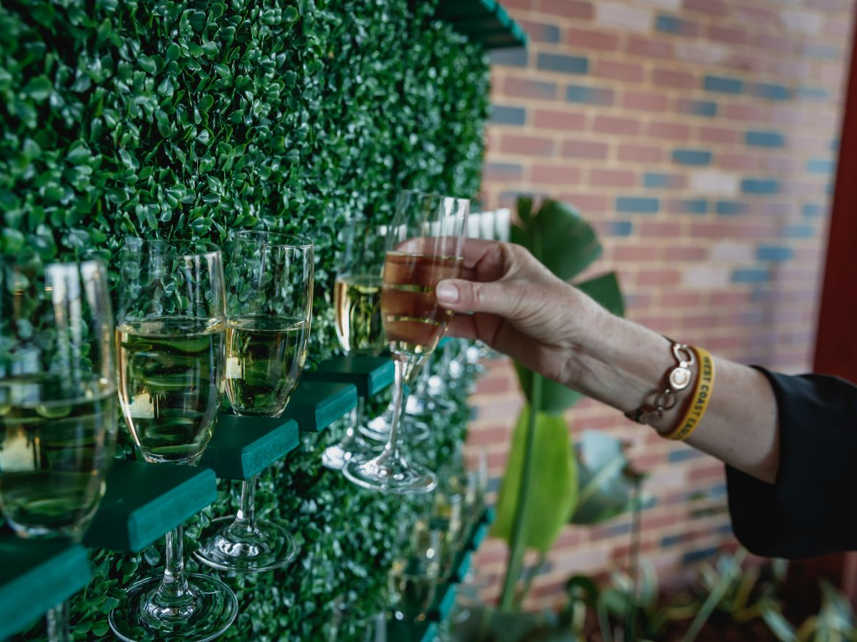Champagne Wall with Faux Green Hedge | The Event Mill