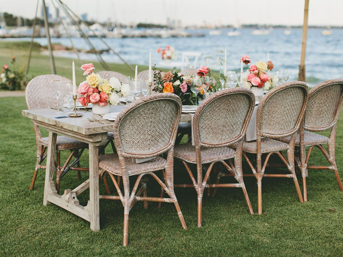 Wedding dining table and Hampston dining chairs set with rustic decorations.