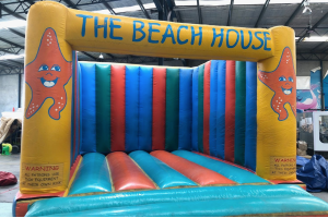 Photograph of The Beach House Bouncy Castle – 5.5mW x 5mD x 3mH (Operator charged per hour $45 + GST)