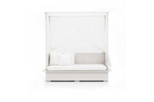 Photograph of White Rattan Canopy Daybed with Sheer Drapes