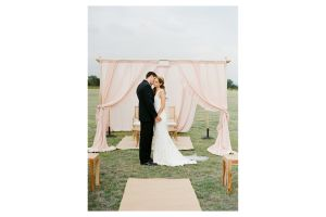 Photograph of Arbour – Bamboo Four Post with drapery (3 Drape Colour Options)