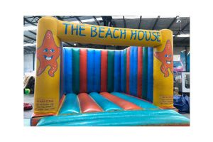 Photograph of The Beach House Bouncy Castle – 5.5mW x 5.6mD x 3.3mH (Operator charged per hour $45 + GST)
