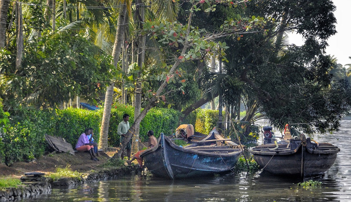 villagers talking backwaters wooden in Kerala