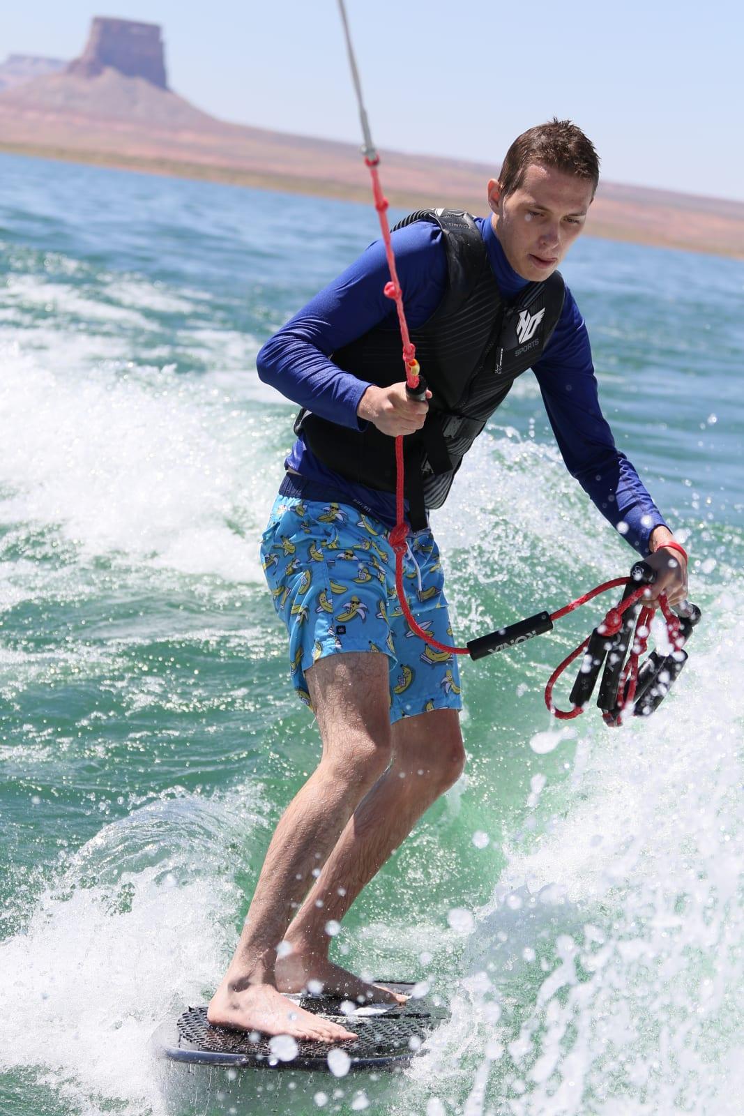 Luke surfing at Lake Powell after 4 brain surgeries. Amazing.